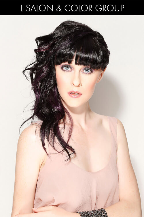Asymmetrical Hairstyle with Blunt Bangs and Curls