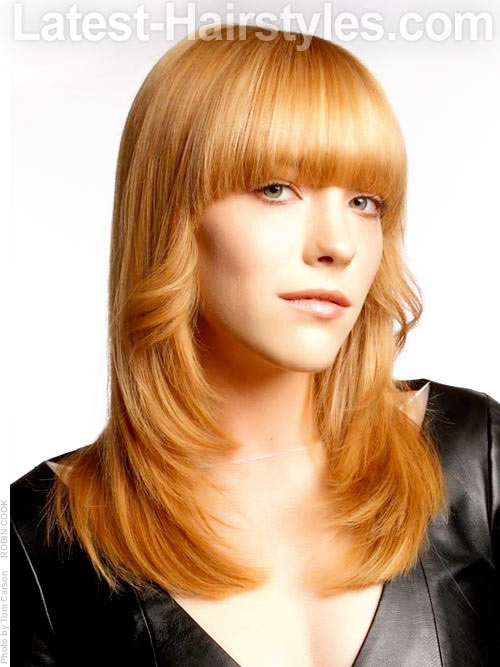 Long hairstyle flipped with rounded bangs