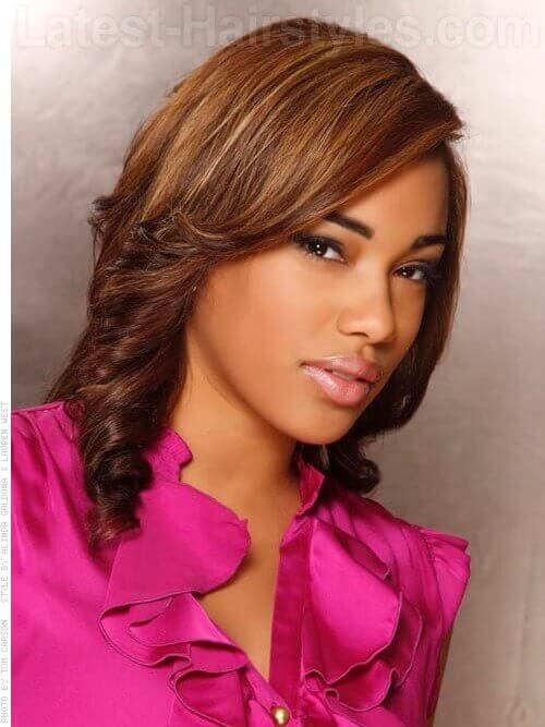 A medium shoulder length hairstyle with curls side view