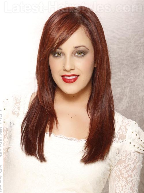 A rich red long and sleek hairstyle