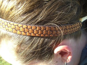 a hand tooled leather headband