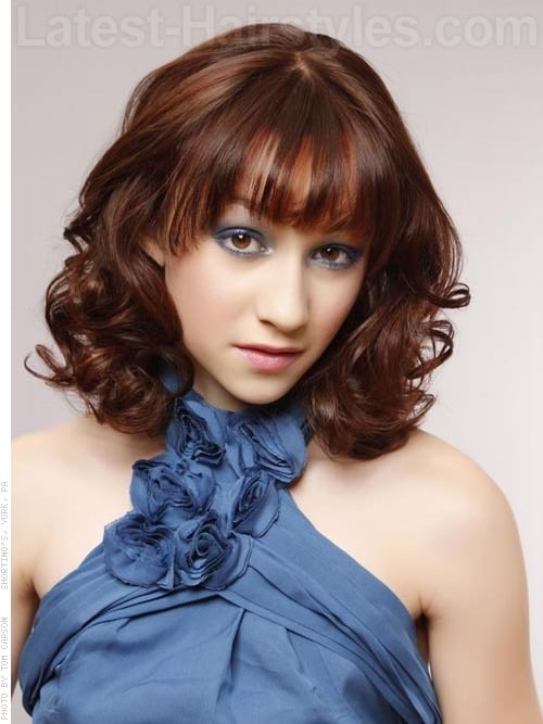 Curved and Curly Medium Look with Bangs