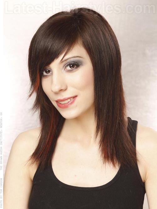 A dark cherry red medium and layered hairstyle