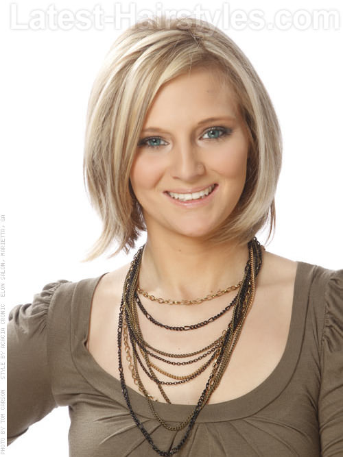 This soft, rounded medium length bob hairstyle gets a a playful finish ...