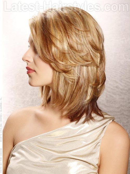 A medium layered hairstyle side view