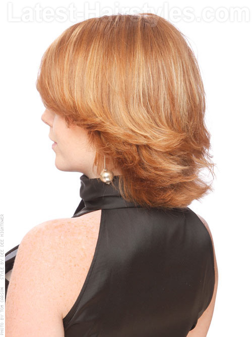 Short choppy and layered flipped haircut back angle