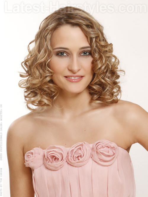 Medium Naturally Curly Shoulder Length Look