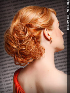 red lowlights with bun updo
