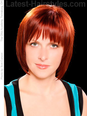 Medium red hair with bowed wispy bangs
