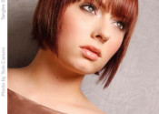Short red bob hairstyle with wispy bangs