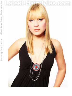 Long blonde hair with heavy straight blunt bangs