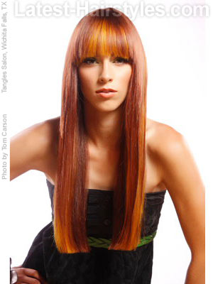 Woman with really long straight hair and bangs