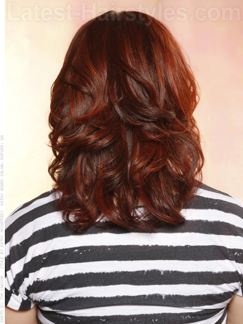 Dark colored hairstyle with layers and waves back view