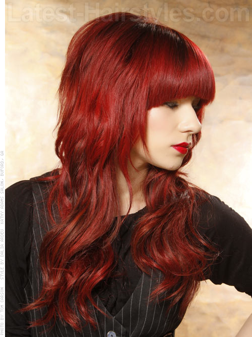 red wavy hairstyle with bangs