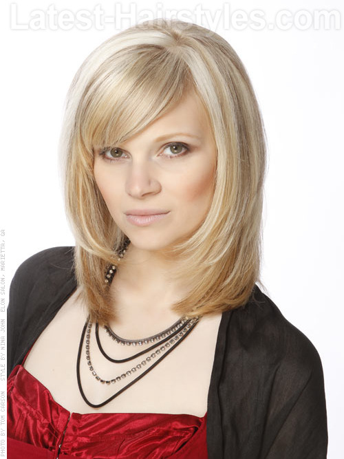 A layered haircut with long bangs