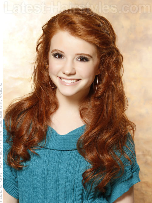 Teenager with long wavy red hair