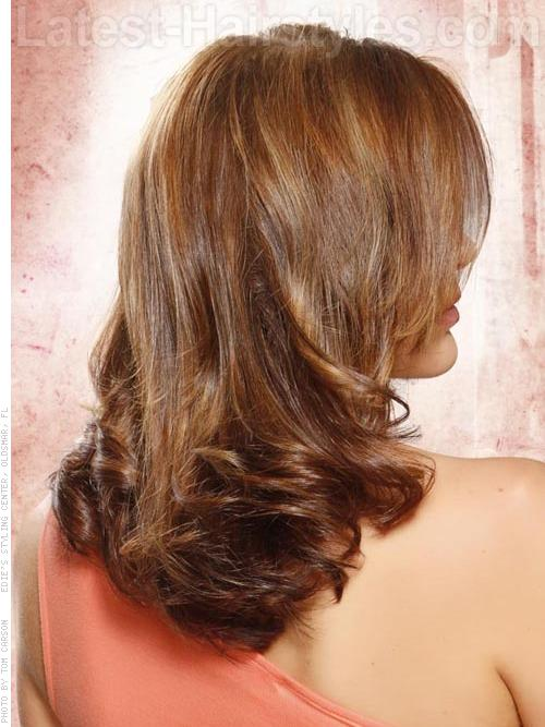 Rich Auburn Long Wavy Hair with Highlights Side View