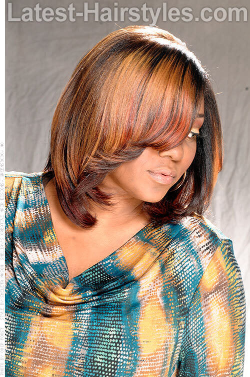 Medium Hairstyle with Layers and Fun Flip