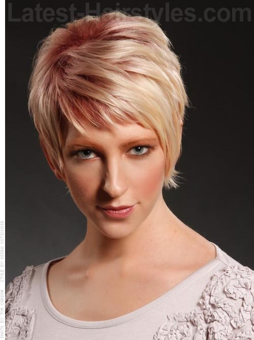 Pale Blonde Sculpted Pixie Haircut with Longer Bangs