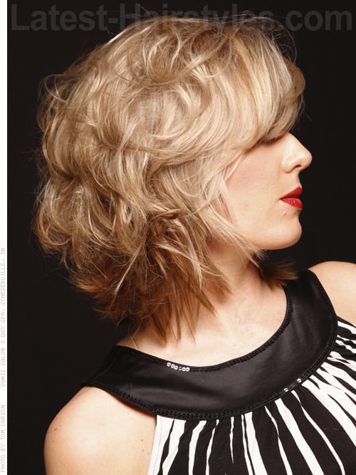 Medium Blonde Layered Style - Lots of Movement and Long Bangs