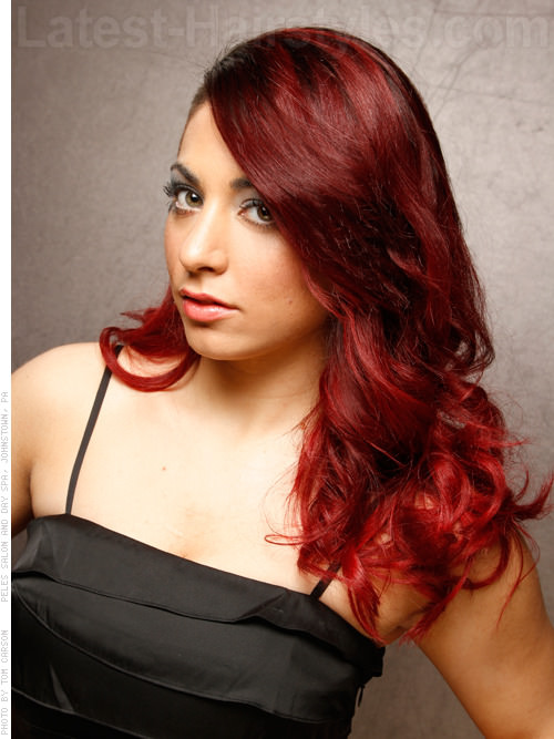 winter firecracker red wavy look 20 Winter Hair Colors We Absolutely Really like hairstyles