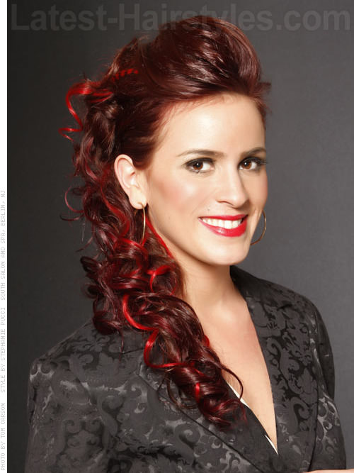 Long Red Curly Side Hairstyle for Prom with Peek-a-Boo Highlights