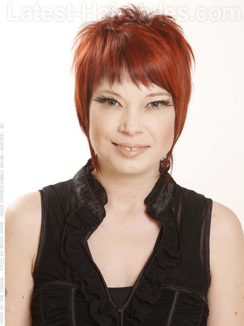 Modern Mullet Red Short Haircut with an Impact and Cute Bangs
