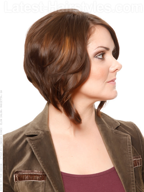 Perfectly Sculpted Brunette Shiny Medium Haircut With Angled Highlights