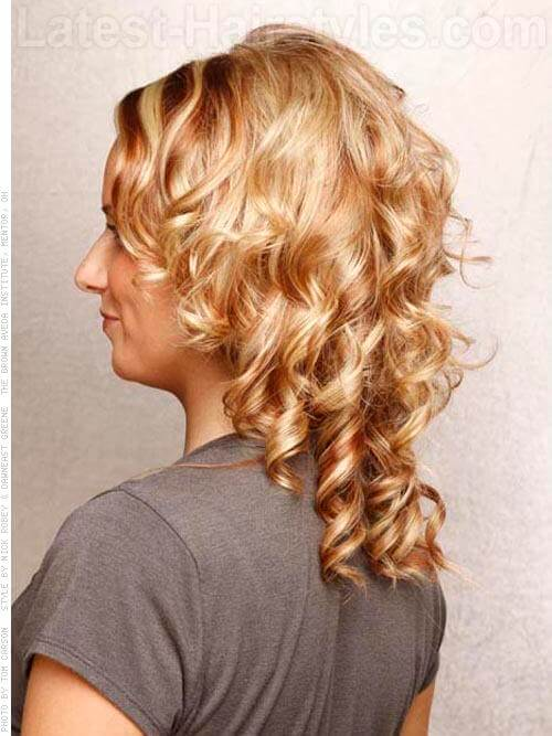 Contrasting Blonde Hair Highlights on Medium Curly Style Side View