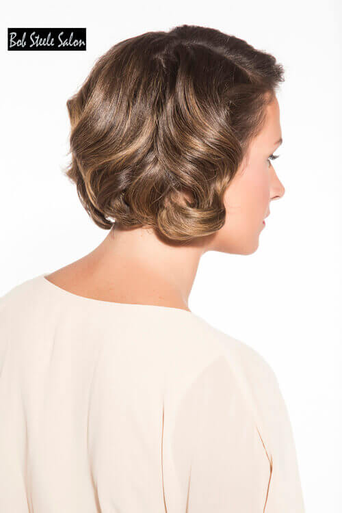 Elegant Short Hairstyle for Older Women with Curls Side