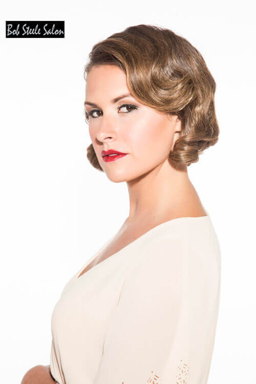 Elegant Short Hairstyle for Older Women with Curls