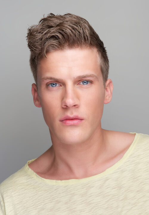 Hairstyle for Men with Sleek Sides and Waved Fringe