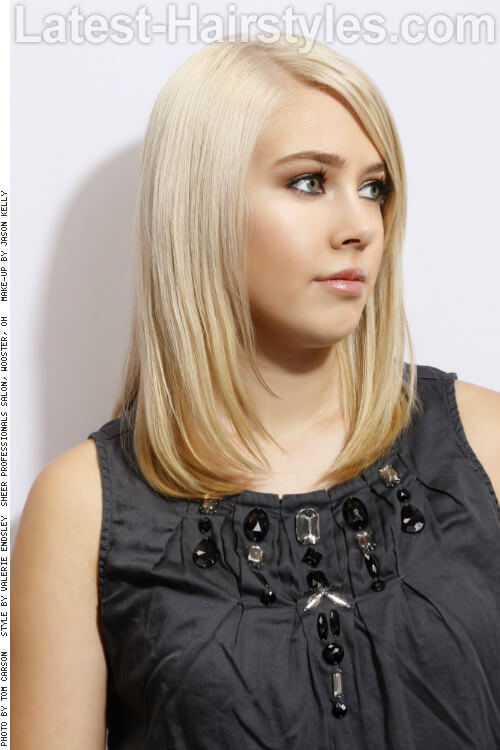 Medium Haircut with Face Framing Layers Side