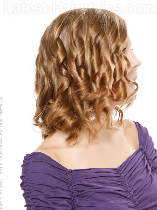 Medium Hairstyle with Tight Curls Side