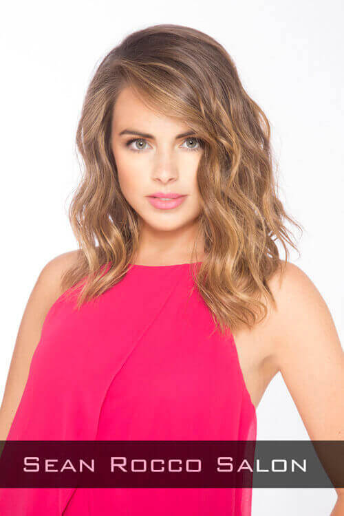 An exquisite deep side part with subtle waves