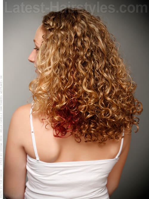 Curly Hairstyle with Pop of Red Back