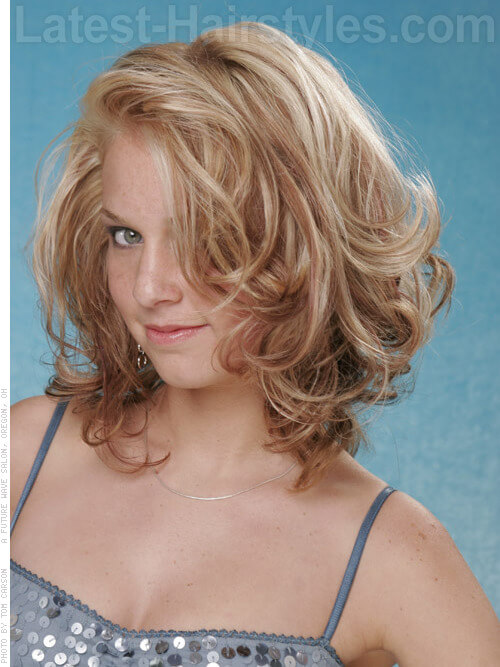 Medium Blonde Hairstyle with Curls and Highlights Side View