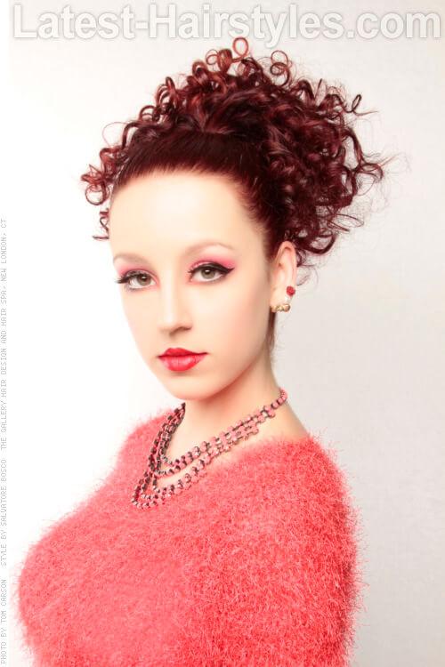 Sleek Ponytail with Curls
