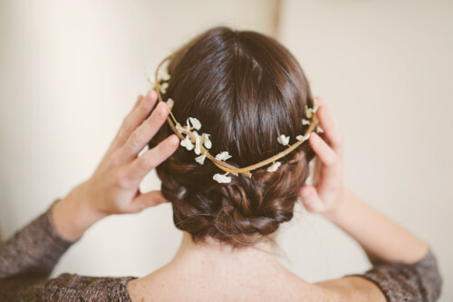 Flower Hair Accessory In Twisted Maiden Bun Braid