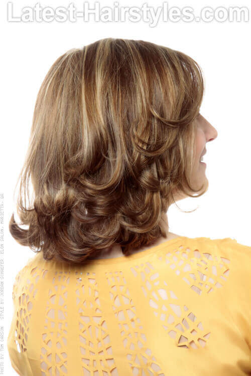 Layered Medium Hairstyle with Side Swept Fringe Back