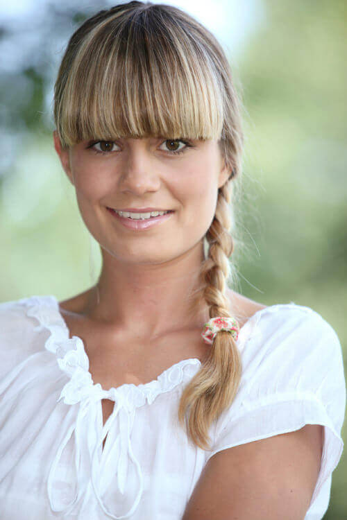 Long Blonde Hairstyle with Braid and Blunt Bangs