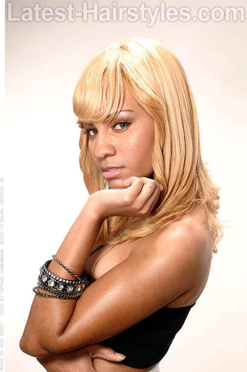 Bold Blonde Hairstyle with Bangs