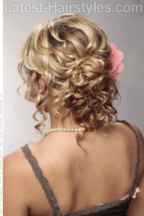 Blonde Updo with Curls and Flower Back View