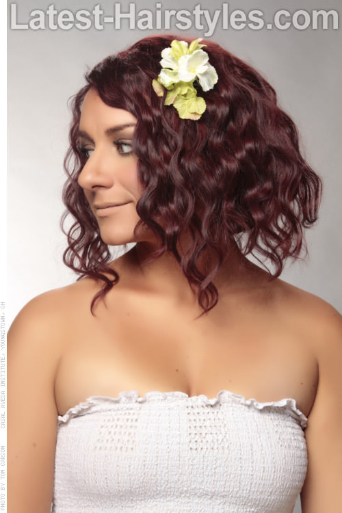 Medium Curly Hairstyle with Flower Side View