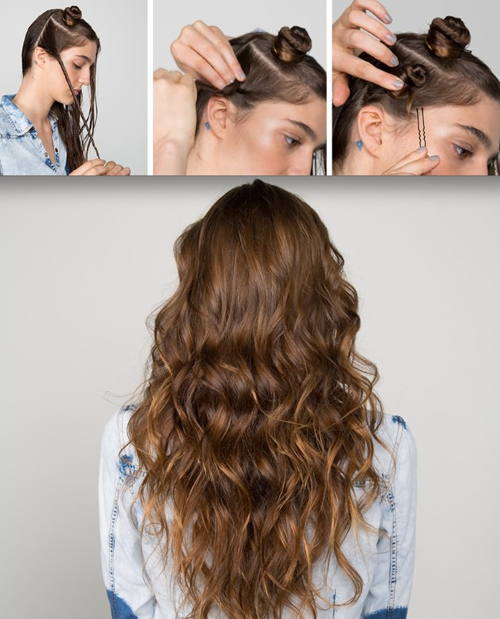 Girl making mini buns on her head using bobby pins. Girl with wavy hair down and facing away from camera.