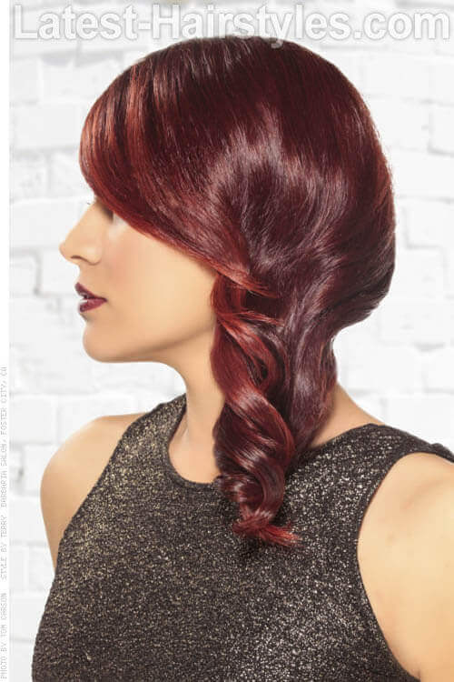 Side Swept Curls with Cranberry Hair Color Side