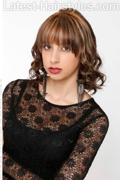 Medium Hairstyle with Thick Bangs