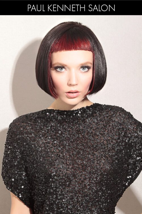 Dramatic Winter Hair Color with Red Bangs