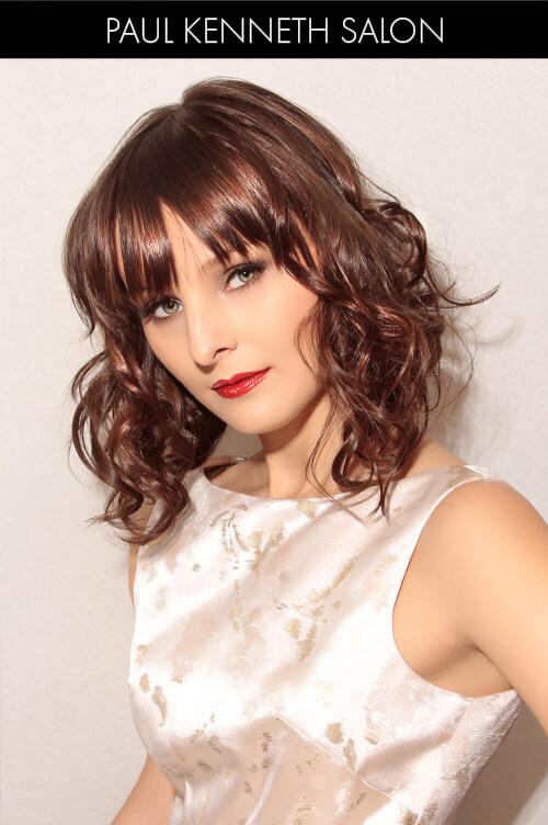Hairstyle with Curls and Eye Grazing Bangs