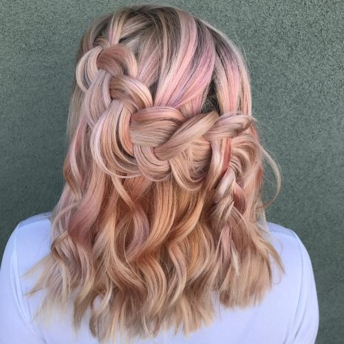 A medium layered hairstyle with french braids